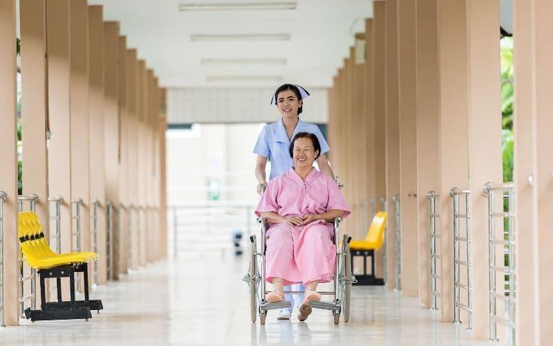 nurse with patient in wheelchair